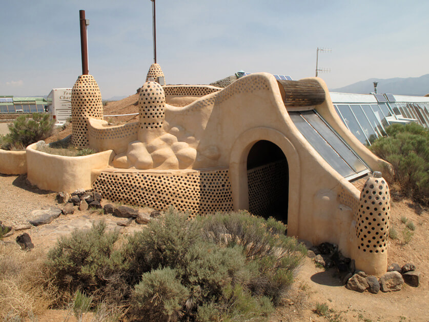 """Earthships. Taos, NM"" by Cecilia is licensed under CC BY 2.0"